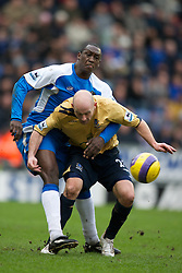 Wigan, England - Sunday, January 21, 2007: Wigan Athletic's Emile Heskey and Everton's Lee Carsley during the Premier League match at the JJB Stadium. (Pic by David Rawcliffe/Propaganda)