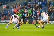Grant Gilchrist (#5) of Edinburgh Rugby runs at Billy Burns (#10) and Nick Timoney (#6) of Ulster Rugby during the Guinness Pro 14 2018_19 match between Edinburgh Rugby and Ulster Rugby at the BT Murrayfield Stadium, Edinburgh, Scotland on 12 April 2019.
