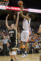 UVA's Lyndra Littles (1) shoots over Wake Forest's Corienne Groves (33).  The Cavaliers defeated the Demon Deacon 77-71 on January 11, 2007 for their first ACC win in the John Paul Jones Arena in Charlottesville, VA.<br />