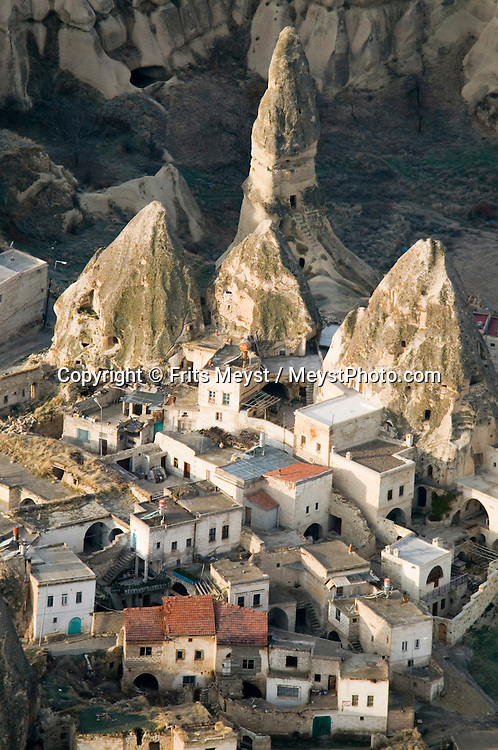 Goreme, Cappadocia, Nevsehir, Turkey, December 2009. Flying over the village of Goreme in the rocks. Hot air ballooning is the number one activity in Capadocia. The fairy landscape of Goreme National Park is unique in its kind. Millions of years long, wind and water sculpted the tuffstone into spectacular rock formations.  Photo by Frits Meyst/Adventure4ever.com