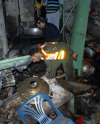 61017758<br /> Rescuers inspect the blast site in northwest Pakistan s Peshawar on Feb. 4, 2014.  At least eight people were killed and 25 others injured on Tuesday evening as a blast hit a busy market in Peshawar, local media reported, Tuesday, 4th February 2014. Picture by  imago / i-Images<br /> UK ONLY