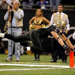 November 28, 2011; New Orleans, LA, USA; New Orleans Saints tight end Jimmy Graham (80) dives across the goal line for a touchdown against the New York Giants during the third quarter of a game at the Mercedes-Benz Superdome. Mandatory Credit: Derick E. Hingle-US PRESSWIRE