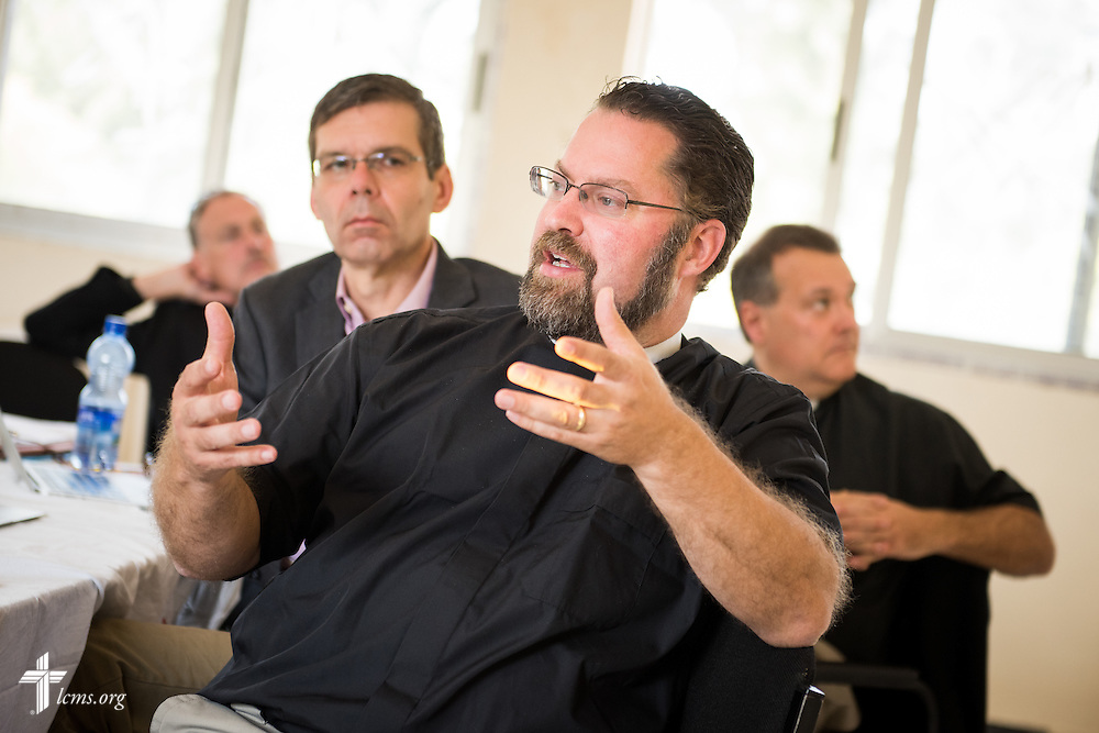 The Rev. Dr. Albert C. Collver, director of Church Relations and Regional Operations for the LCMS, leads a partnership discussion at Mekane Yesus Seminary in Addis Ababa, Ethiopia, on Wednesday, Nov. 12, 2014. Behind Collver is the Rev. Dr. Jeffrey Kloha, provost of Concordia Seminary, St. Louis, the Rev. Dr. Lawrence R. Rast, Jr., chairman of the Commission on Theology and Church Relations (CTCR) and president of Concordia Theological Seminary in Fort Wayne, Ind., and the Rev. Dr. Joel D. Lehenbauer, LCMS executive director of the Commission on Theology and Church Relations. LCMS Communications/Erik M. Lunsford