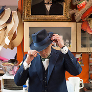 May 3, 2012 - Manhattan, NY : Musician and composer Michael Arenella tries on a hat he has had refurbished, in the workroom of Worth & Worth, a men's and women's hat store located at 45 West 57th St. in Manhattan, on Thursday. CREDIT : Karsten Moran for The New York Times