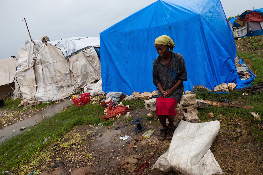 Eve-Rose Geurand sits in next to where her tent stood in one of Port-Au-Prince's tent city's. Wind from hurricane Tomas blew her tent down around 2 AM this morning.