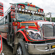 Dramatic paint jobs on chicken buses in Antigua, Guatemala.