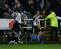 Photo: Andrew Unwin.<br />Newcastle United v Mansfield Town. The FA Cup.<br />07/01/2006.<br />Newcastle's Alan Shearer (R) celebrates his 200th club goal.