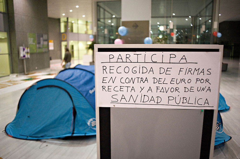 "December 2012, Barcelona, Spain. Hospital employees have occupied the hall of San Pau Hospital to protest against cuts in public health. In the 8th day of this occupation, the employees received the support of the nun Teresa Forcades who talked with them about the industry of health and its privatization process. The hospital employees decided to begin this sine-die occupation against cuts in the public health service on 29th November 2012. In this photo: A placard with the writing: ""Get involved collecting signatures against euro by prescription and a public health"""