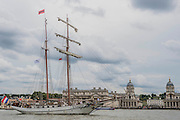 The JR Tolkien passing Greenwich - Royal Greenwich Tall Ships Festival with a fleet of square rigged ships moored on the Thames at Greenwich and Woolwich. The fleet includes two of the biggest Class A Tall Ships - the Dar Mlodziezy and Santa Maria Manuela - which are moored on Tall Ships Island in the river off Greenwich. Tall Ships Festival Day on Saturday 29 August featured free family entertainment and the chance to enjoy a taste of life on the high seas.