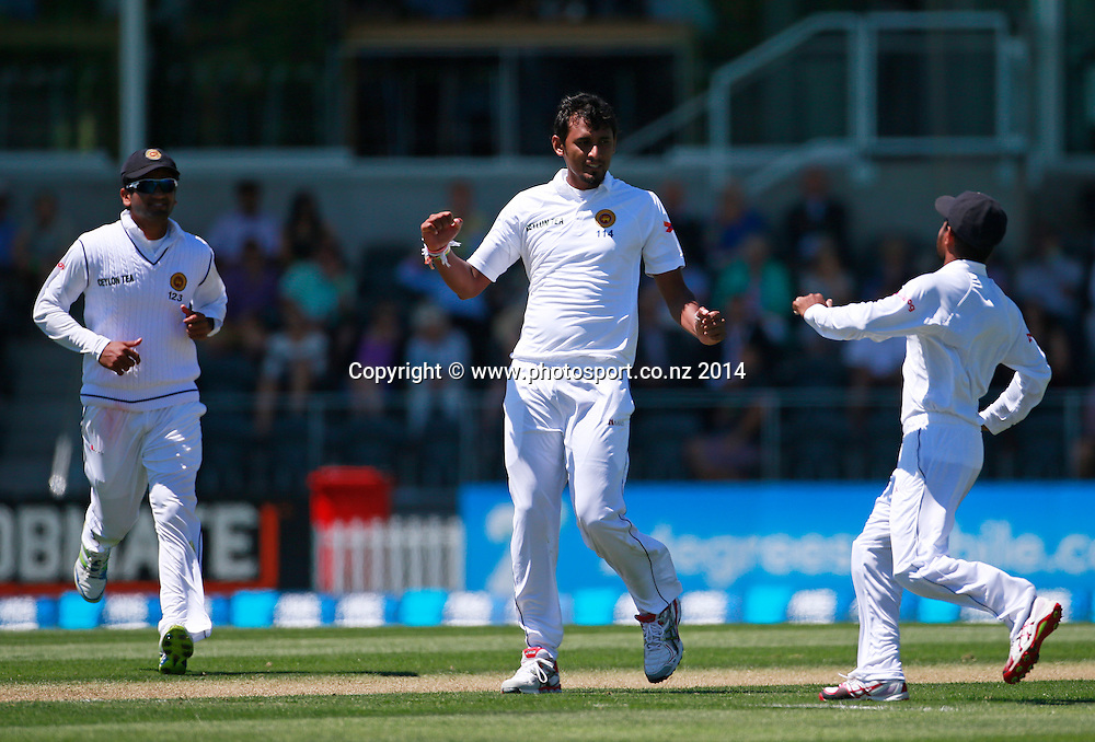 Suranga Lakmal of Sri Lanka celebrates the wicket of Hamish Rutherford of the Black Caps on Day 1 of the boxing Day Cricket Test Match between the Black Caps v Sri Lanka at Hagley Oval, Christchurch. 26 December 2014 Photo: Joseph Johnson / www.photosport.co.nz