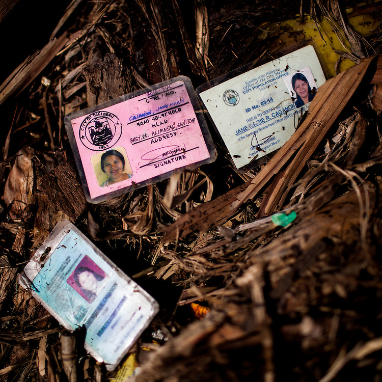 ID cards found next to a body buried under debris.