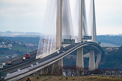 Edinburgh, Scotland, UK. 25 March, 2020. Day two of the Government enforced lockdown in the UK. All shops and restaurants and most workplaces remain closed. Cities are very quiet with vast majority of population staying indoors. Pictured; View of  Queensferry Crossing Bridge with much less traffic than normal. Iain Masterton/Alamy Live News