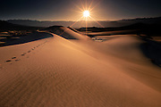 Setting sun casts designs and patterns in the sand in Death Valley National Park in California's desert