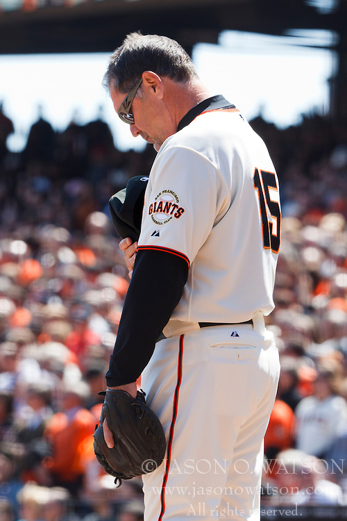 April 8, 2011; San Francisco, CA, USA;  San Francisco Giants manager Bruce Bochy (15) stands with his head bowed before the game against the St. Louis Cardinals at AT&T Park.