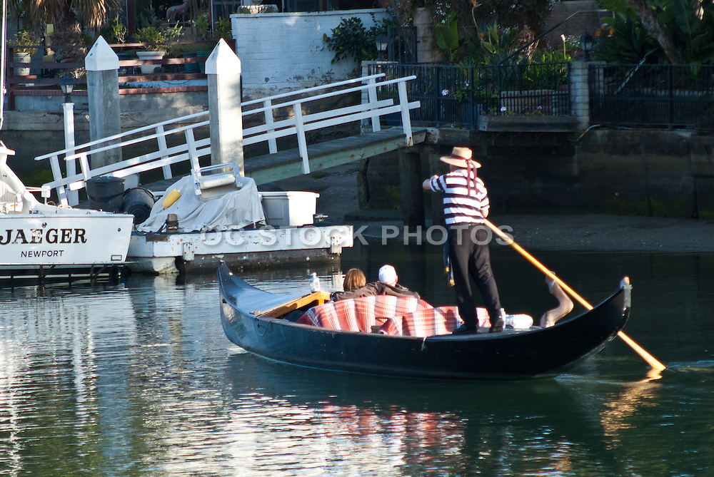 A Gondolier Rowing a Couple in Balboa Cove