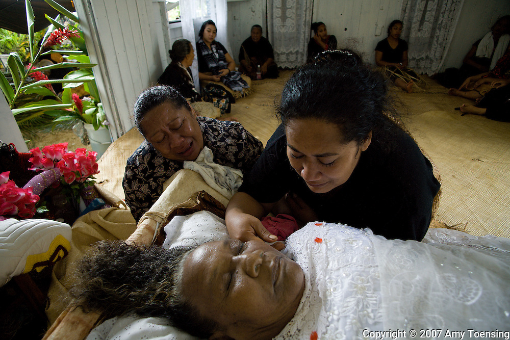 HA'APAI, TONGA - APRIL 04:  Tongan women mourn at the funeral of Kalisi Lolohea Paonga on April 4, 2007 in the village of Pangai, on the island of Ha'apai, Tonga. Tonga is one of the last surviving monarchies in the Pacific islands, however there has been a recent push towards democratic reform, challenging the people of Tonga to maintain their cultural heritage while conforming to modern day capitalism. (Photo by Amy Toensing/ Reportage by Getty Images) _________________________________<br /> <br /> For stock or print inquires, please email us at studio@moyer-toensing.com.