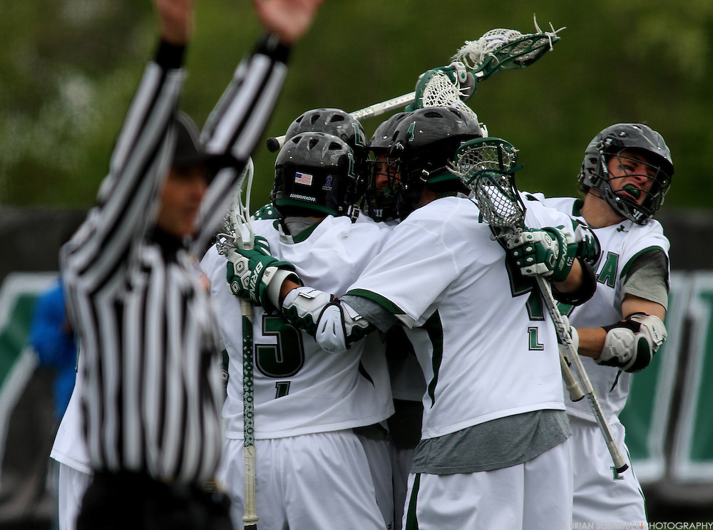 April 28, 2012; Baltimore, MD, USA; Loyola Greyhounds celebrate after attack Justin Ward (not pictured) scores in the final seconds to tie the game against the Johns Hopkins Blue Jays at Ridley Athletic Complex in Baltimore, MD. Mandatory Credit: Brian Schneider-www.ebrianschneider.com