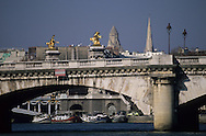 France. Paris pont de la concorde , in the distance  Pont Alexandre III and gold statues