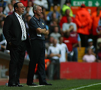 Photo: Paul Thomas.<br /> Liverpool v West Ham United. The Barclays Premiership. 26/08/2006.<br /> <br /> Liverpool manager Rafael Benitez (L)  and West Ham manager Alan Pardew watch the game closely.