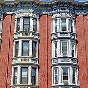 Closeup of a building's facade on Washington Street in Hoboken, New Jersey, USA. Hoboken was once a transportation and warehouse hub but has gone through a gentrification over the last 30 years and is now an upscale bedroom community with close access to New York City which is directly across the Hudson River.
