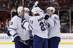 Jan 29, 2010; Newark, NJ, USA; The Toronto Maple Leafs celebrate a goal by Toronto Maple Leafs defenseman Carl Gunnarsson (36) during the first period at the Prudential Center.