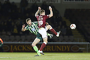 Ryan Sweeney of AFC Wimbledon and James Collins of Northampton Town FC tussle during the Sky Bet League 2 match between Northampton Town and AFC Wimbledon at Sixfields Stadium, Northampton, England on 1 March 2016. Photo by Stuart Butcher.
