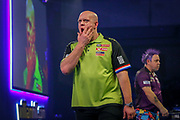 Michael Van Gerwen (Netherlands) walks off the stage looking slightly worried during his match with Peter Wright (Scotland)  in the final of the PDC William Hill World Darts Championship at Alexandra Palace, London, United Kingdom on 1 January 2020.