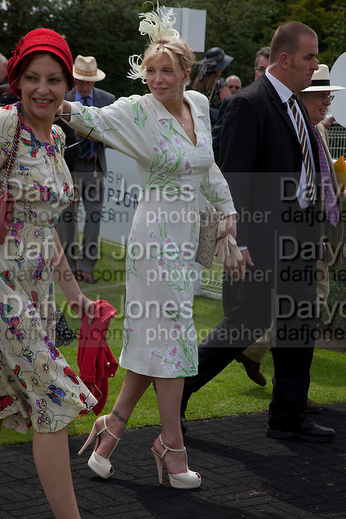 PEARL LOWE; COURTNEY LOVE;; IN THE PADDOCK, Glorious Goodwood. Ladies Day. 28 July 2011. <br /> <br />  , -DO NOT ARCHIVE-&copy; Copyright Photograph by Dafydd Jones. 248 Clapham Rd. London SW9 0PZ. Tel 0207 820 0771. www.dafjones.com.