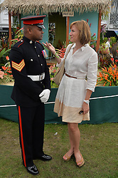 JOHNSON BEHARRY VC and FIONA BRUCE at the 2014 RHS Chelsea Flower Show held at the Royal Hospital Chelsea, London on 19th May 2014.
