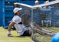 Tennis - 2017 Aegon Championships [Queen's Club Championship] - Day Three, Wednesday<br /> <br /> Men's Singles, Round of 16 - Grigor Dimitrov (BUL) vs Julien Benneteau (FRA)<br /> <br /> Julien Benneteau (FRA) slips under the net after he rushed into net to reach a drop shot at Queens Club<br /> <br /> COLORSPORT/DANIEL BEARHAM