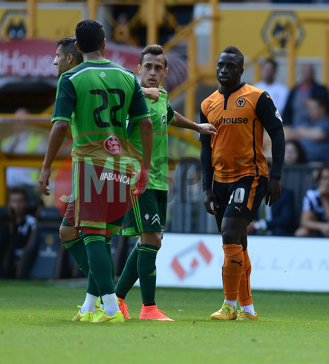 Wolverhampton's Nouha Dicko has words with Celta Vigo's Gustavo Cabral  - Photo mandatory by-line: Alex James/JMP - Tel: Mobile: 07966 386802 2/08/2014 - SPORT - FOOTBALL - Bristol - Memorial Ground  -   Wolverhampton vs  Celta Vigo - preseason