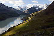Lac des Dix, near Cabane de Prafleuri, Switzerland. Mont Blanc de Cheilon can be seen at the head of the valley.