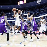 06 March 2017: Denver Nuggets guard Gary Harris (14) goes for the jump shot over Sacramento Kings guard Ben McLemore (23) and Sacramento Kings forward Skal Labissiere (3) during the Denver Nuggets 108-96 victory over the Sacramento Kings, at the Pepsi Center, Denver, Colorado, USA.