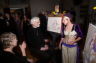 (from left) Artists Elizabeth Swisher and Jerry Edwards chat with model Stephanie Elsass during a break of the live figure drawing, part of the 2011 Art Ball at the Dayton Art Institute, Saturday, June 11, 2011.  The work of all four artists were part of the silent auction.