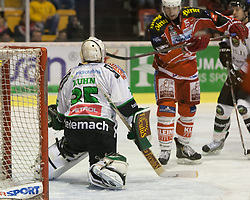 17.12.2013, Stadthalle, Klagenfurt, AUT, EBEL, KAC vs Olimpija Ljubljana<br /> , 54. Runde, im Bild Tor zum 1:0 für den KAC durch Thomas Pöck (KAC, #22), Jerry Kuhn (Olimpija Ljubljana, #35), Paul Schellander (Kac, #15)<br />  // during the Erste Bank Icehockey League 54th Round match betweeen EC KAC and Olimpija Ljubljana<br /> at the City Hall, Klagenfurt, Austria on 2013/12/17. EXPA Pictures © 2013, PhotoCredit: EXPA/ Gert Steinthaler