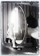 little child with window and mirror 1900s