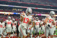GLENDALE, AZ - JANUARY 01: Quarterback Stephen Collier #13 of the Ohio State Buckeyes walks onto the field before the BattleFrog Fiesta Bowl against the Notre Dame Fighting Irish at University of Phoenix Stadium on January 1, 2016 in Glendale, Arizona.  (Photo by Jennifer Stewart/Getty Images)