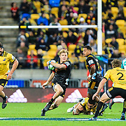 Damian McKenzie runs during the super rugby union game between Hurricanes and Chiefs, played at Westpac Stadium, Wellington, New Zealand on 13 April 2018. Hurricanes won 25-13.