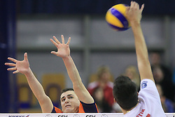 Andrej Flajs of ACH Volley vs Pavel Bartik at volleyball match of CEV Indesit Champions League Men 2008/2009 between ACH Volley Bled (SLO) and Beauvais Oise (FRA), on December 11, 2008 in Hala Tivoli, Ljubljana, Slovenia. (Photo by Vid Ponikvar / Sportida)