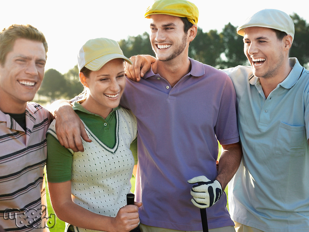 Smiling group young golfers with arms around each other's shoulders on golf course