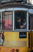 Close up of a yellow streetcar in Largo do Calhariz, Lisbon, Portugal