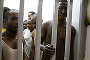 African migrant prisoners accused of being mercenary fighters for Qaddafi  in a prison in Tripoli, Libya `September 1,2011. Khatar says that he was intentionally burned by Rebels who accused him of being a mercenary . The other prisoners from African countries claimed they were arrested for the same reason . The prisoners complained of lack of sanitation and proper food . (Photo by Heidi Levine/Sipa Press).