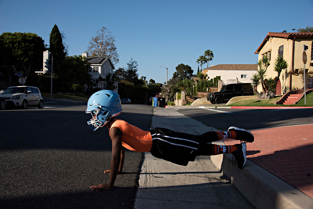 """Maxwell """"Bunchie"""" Young, 10, does one-legged pushups before running hills with his speed coach. """"I've never seen any athlete, at any level, as committed to training as Bunchie is,"""" said his speed coach Jonathan Ligons, 35. """"He asks to stay longer, do more, and be pushed harder each time."""""""