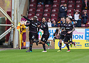 28th April 2018, Fir Park, Motherwell, Scotland; Scottish Premier League football, Motherwell versus Dundee; Cedric Kipre of Motherwell is congratulated after scoring by Charles Dunne