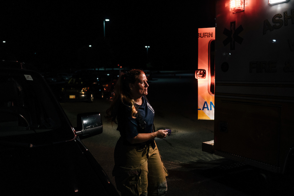 Heidi Wallner, firefighter, National Registry emergency medical technician, and safety supervisior for LSG Sky Chefs, responds to a call at a local high school with her crew in Ashburn, Virginia on Sept. 23, 2015. Wallner is a volunteer, working one night a week with other EMTs.