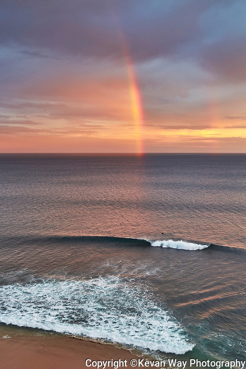 rainbow surfing at 13th Beach