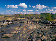 Industrial barrens looking north at Inco Superstack in Copper Cliff from Kelly Lake Road. Kelly Lake. 1999<br />Greater Sudbury<br />Ontario<br />Canada