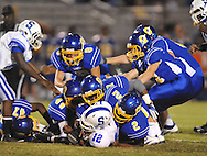 Oxford High's Aaron McNeal (2), Oxford High's Jarquis Adams (7), and Oxford High's Xavier Pegues (44) vs. Senatobia in high school football in Oxford, Miss. on Friday, September 9, 2011. Oxford won 40-20.