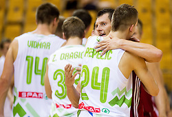 Klemen Prepelic of Slovenia and Janis Blums of Latvia after the friendly match between National teams of Slovenia and Latvia for Eurobasket 2013 on August 2, 2013 in Arena Zlatorog, Celje, Slovenia. Slovenia defeated Latvia 71-67. (Photo by Vid Ponikvar / Sportida.com)