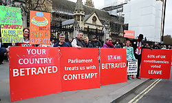March 27, 2019 - London, UK - Pro-Brexit demonstrators with large placards protests outside the Houses of Parliament. Later today the MPs will votes on series of indicative votes on alternatives to Prime Minister Theresa May's Brexit deal. (Credit Image: © Dinendra Haria/London News Pictures via ZUMA Wire)